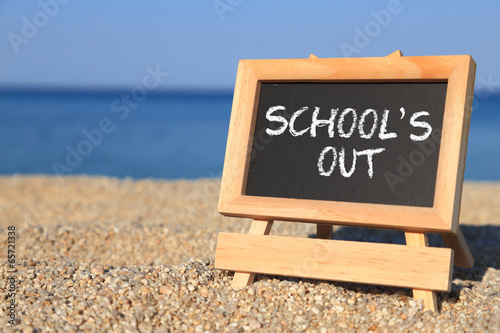 canvas print picture Blackboard with School's out text on the beach