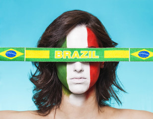 Italian supporter for FIFA 2014 with Brazil flag