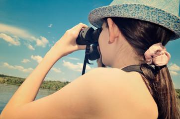 teen girl looking through binoculars closeup toning
