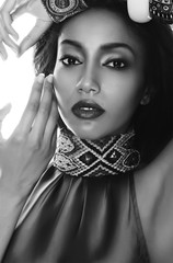 Beautiful mulatto brunette in ethnic accessories, and bracelet