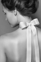 Beautiful gentle girl with silk bow on the back