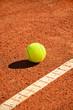 tennis ball near markup diagonal vertical