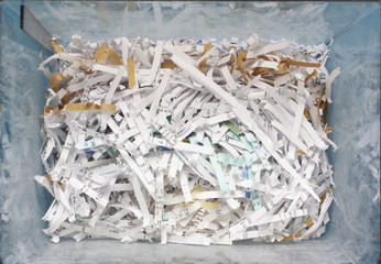 Plastic container of shredded confidential documents