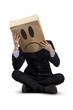 Worried businessman with cardboard head