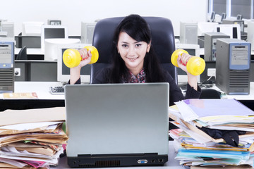 Woman working and workout in office