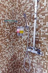 Modern designer tap and shower in bathroom