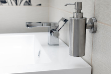 Chromium-plate tap on white sink.
