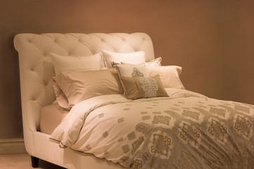 Neutral tone plush bed  and pillows