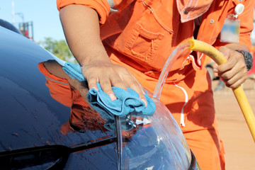 A Hand washing  car with