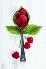 Fresh organic raspberry in a spoon.  Selective focus