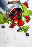 Fresh Berries on Wooden Background.