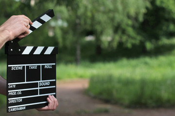 clapperboard in hands
