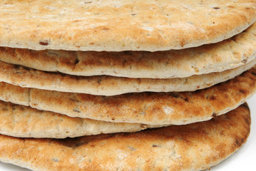 Close-up of flame baked pitas