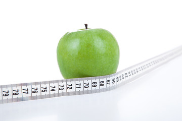 green apple with a ruler