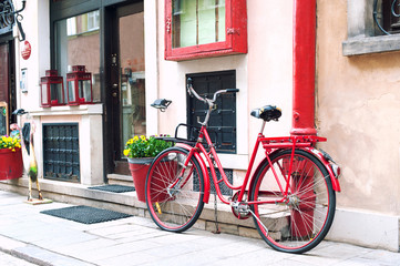 Red rustic retro bicycle. Outdoors.