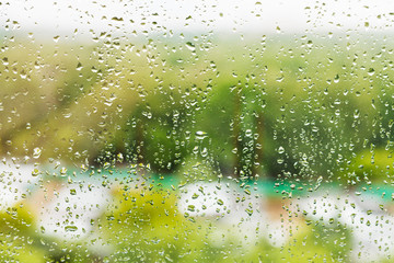 rain drops on window glass in summer day