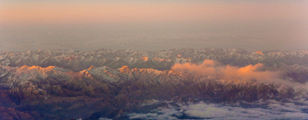 beautiful view from the aircraft to the mountains of the Himalay