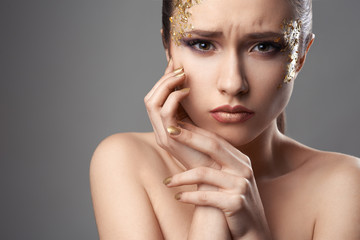 pretty girl with golden make-up art