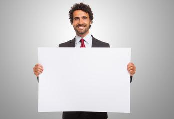 Man holding a blank board.