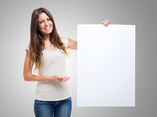 Woman showing a white board