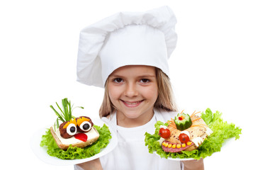 Happy smiling chef kid with creative sanwiches