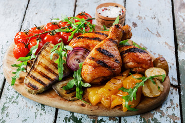 Grilled chicken drumstick with vegetables