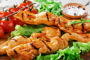 Grilled chicken on wooden skewers