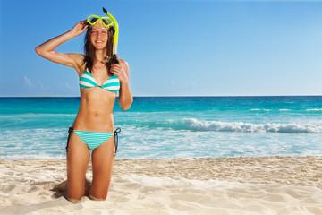 Young girl posing wearing scuba