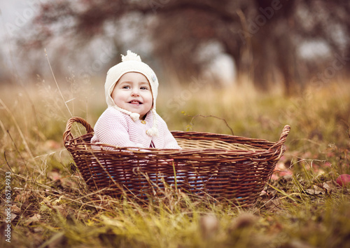 canvas print picture Happy little girl in basket