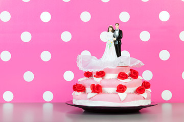 Couple on top of wedding cake