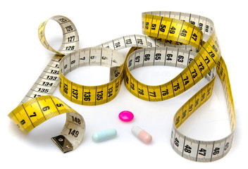Measuring tape with pills