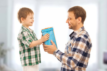 Happy son gives his father gift