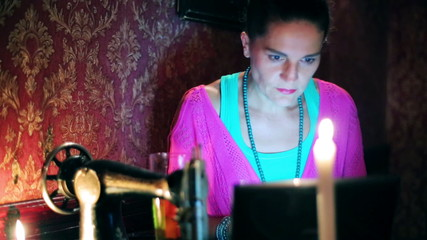 Woman with laptop sitting in a pub, steadycam shot