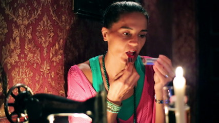 Young woman put lipstick in a pub, steadycam shot
