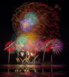 Fireworks of multiples colors with reflections on water