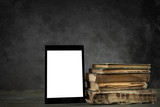Old yellowed books with self-designed tablet computer - 65739517