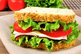 Sandwich with meat, tomato, lettuce and cheese