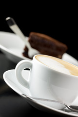 Delicious caffe latte with chocolate cake
