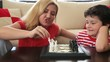 Mom teaches son how to play chess