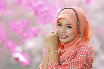 Beautiful muslim girl pink hijab wearing fashion