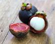 Fresh mangosteen fruit on wood