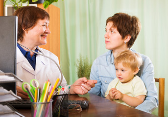 mother with baby listening  pediatrician doctor