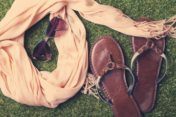 Summer womens fashion accessories on grass background