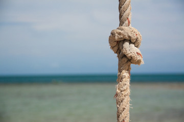 knot on the rope and sea