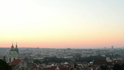 Sunrise over Prague - roofs of urban buildings