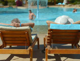 Elderly couple at pool