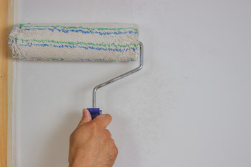 Man hand with roller painting 4