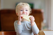Cute toddler girl eating sandwich in the morning - 65746525