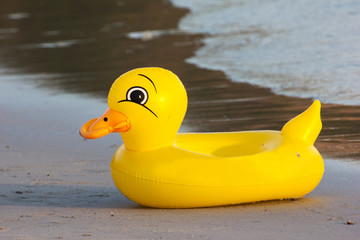 duck rubber ring, duck swim-ring on the beach