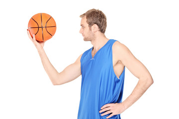 Man looking at a basketball
